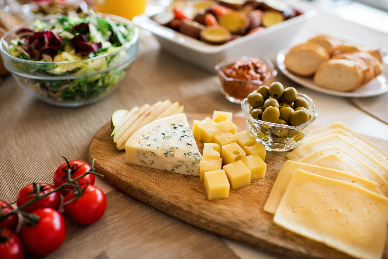 a charcuterie board of things you can still eat with sensitive teeth, braces, or removed wisdom teeth